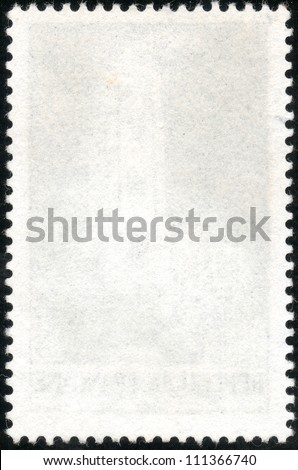 Blank vertical postage stamp isolated on a black background - stock photo