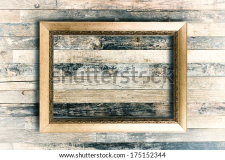 Blank vintage frame on wooden wall background - stock photo