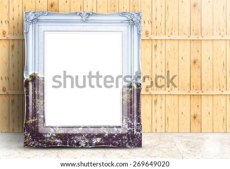 Blank Vintage frame with double exposure of tree landscape image lean on marble floor and plank wooden wall,Template mock up for adding your design - stock photo