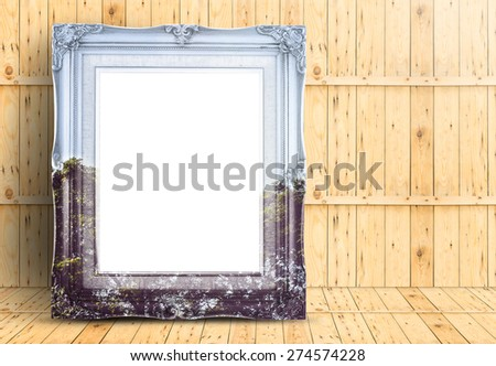 Blank Vintage frame with double exposure of tree landscape image lean on marble floor and plank wooden wall,Template mock up for adding your design. - stock photo