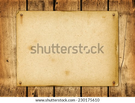 Blank vintage poster nailed on a wood board panel - stock photo