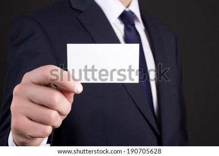 blank visiting card in business man hand