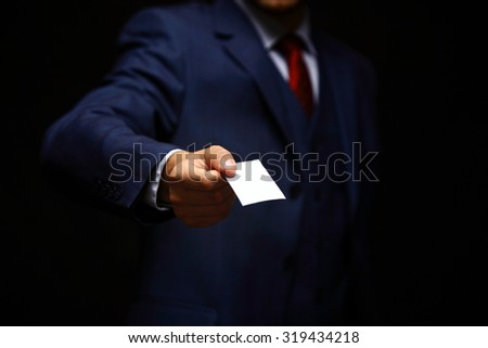 blank visiting card in business man hand - stock photo