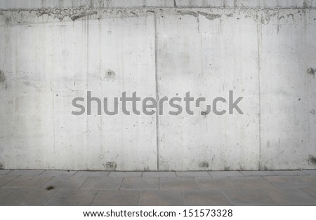 blank wall and sidewalk background - stock photo