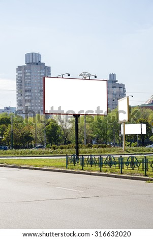 Blank white advertising banners near the road. Put your text or images inside - stock photo