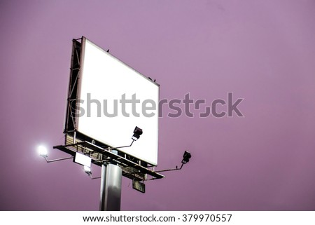 Blank white billboard on evening sky