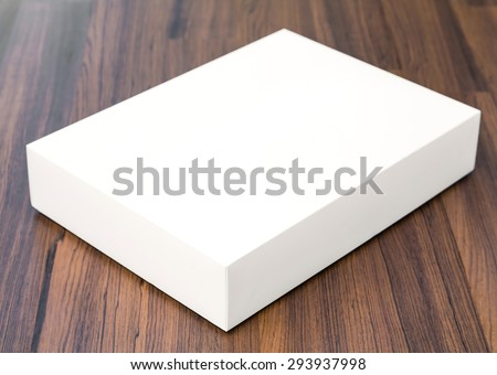 Blank white box mock up on wood background - stock photo