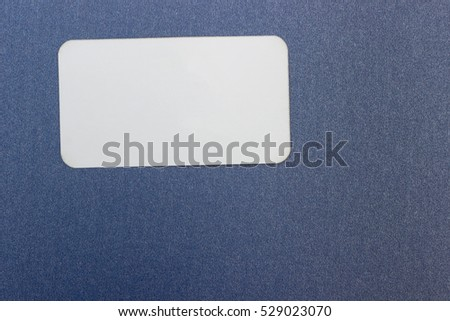 Blank white business cards on color background.