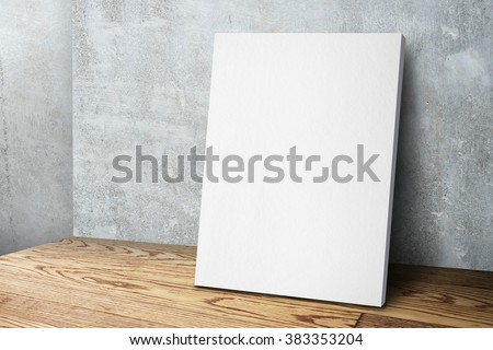 Blank white canvas frame leaning at concrete wall and wood floor, Mock up template for adding your design.