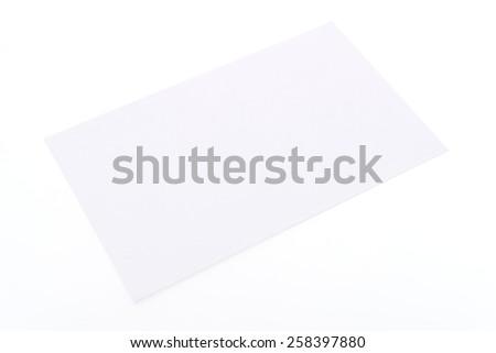 Blank white card isolated on white background - stock photo
