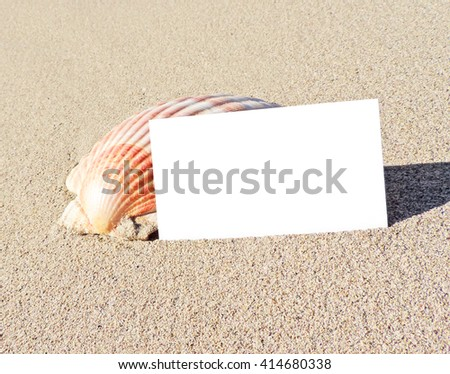 blank white card with copy space. Beach scene with shell and white sign.  - stock photo