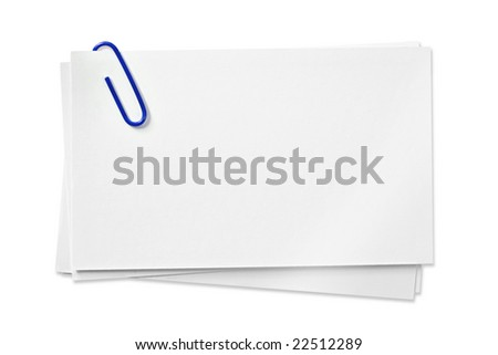 Blank white cards with blue paperclip, isolated on white background.  Clipping path included. - stock photo