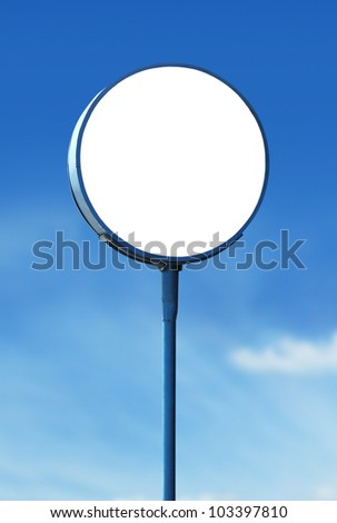blank white circle sign board under blue sky background - stock photo