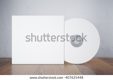 Blank white compact disk with cover on wooden table and concrete wall background. Mock up, 3D Rendering - stock photo