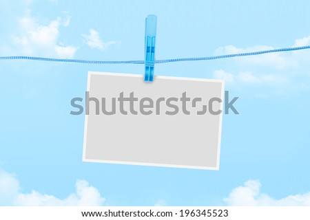 Blank white empty paper frame for your message on cloudy background.