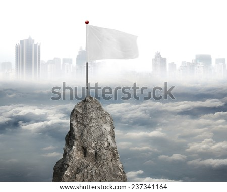 blank white flag on the mountain peak with cloudy sky cityscape background - stock photo