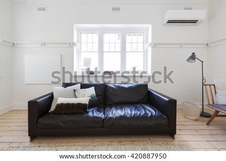 Blank white framed art in contemporary interior styled living room - stock photo