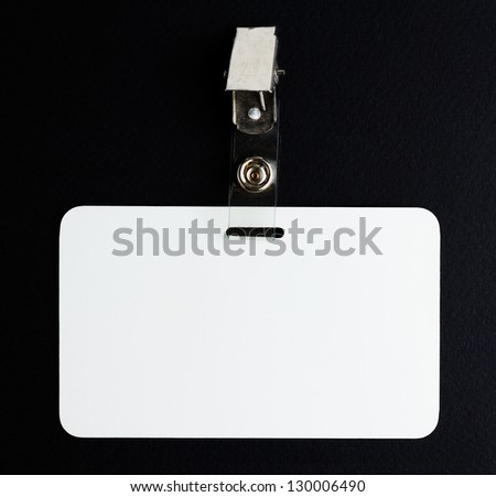 blank white id card on black background - stock photo