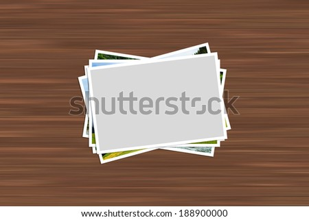 Blank white image frame with border for your photography on wooden table.