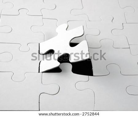 blank white jigsaw puzzle - stock photo