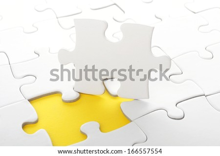 blank white jigsaw puzzle with missing piece