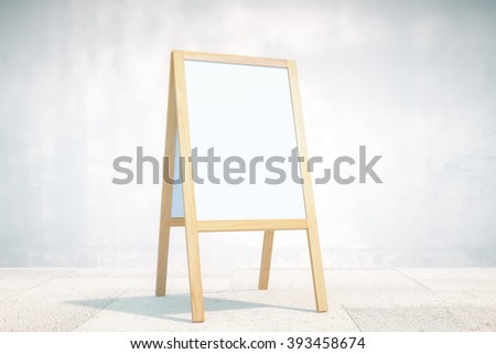 Blank white menu stand on concrete wall background. Mock up - stock photo