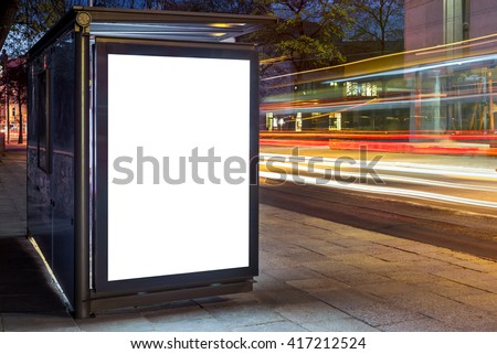 Blank white mock up of vertical light box in a bus stop at night - stock photo