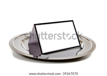 Blank white note-card lined in black on a silver tray on a white background - stock photo
