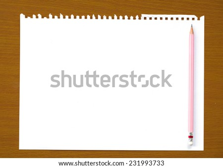 Blank white notebook an pencil on wooden table, background, template