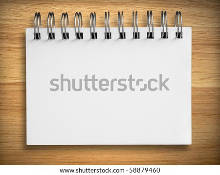 blank white notebook on rubber wood background - stock photo