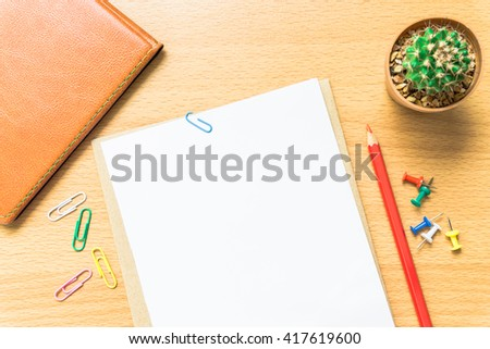 Blank white paper and colored pencil on the desk. - stock photo