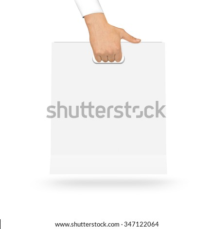 Blank white paper bag mock up holding in hand. Empty plastic package mockup hold in hands isolated on white. Consumer pack ready for logo design or identity presentation. Product packet handle. - stock photo