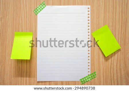 Blank white paper note and post it note paste on wooden cabinet - stock photo