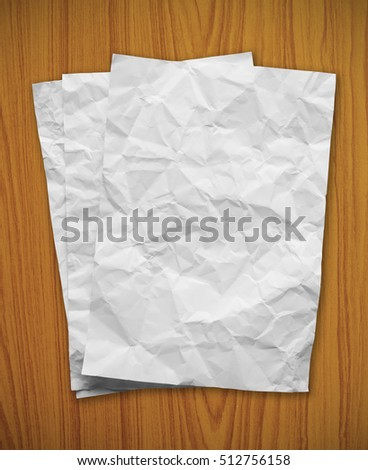 Blank white paper on a wooden background