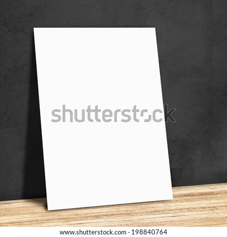 blank white paper on the black wall and the wooden floor,Mock up for your content - stock photo
