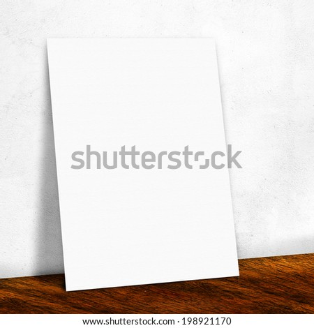 blank white paper on the black wall and the wooden floor,Mock up for your content