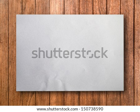 Blank White Paper on Wood Background With Shadow - stock photo