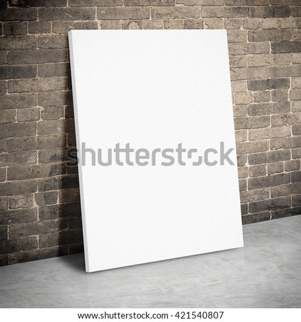 Blank white paper poster on the grunge brick wall and cement floor,Mock up to display or montage of your content.