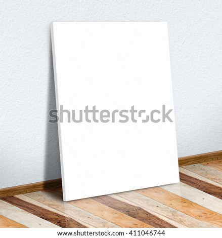 Blank white paper poster on white wall and wooden floor,Mock up to display or montage of your content.