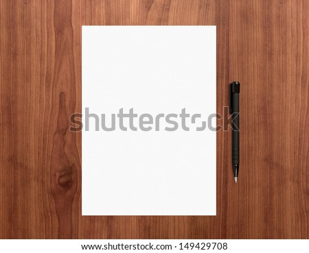 Blank white paper with pen on a wooden desk. High quality graphic collage. - stock photo
