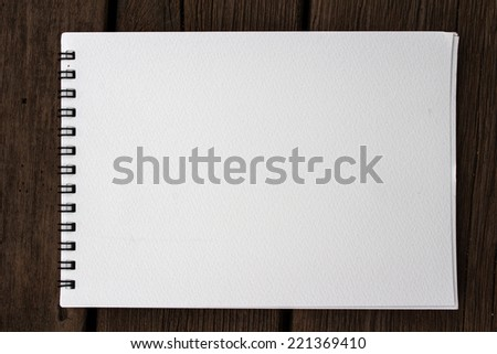 Blank white pond paper realistic spiral notepad notebook on wood background - stock photo