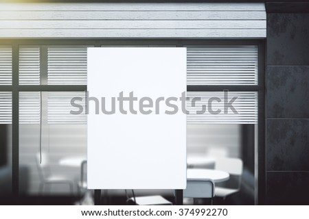 Blank white poster on transparent wall in modern conference office, mock up - stock photo