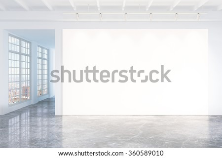 Blank white poster on white wall in empty loft room with concrete floor and big windows, mock up 3D Render - stock photo