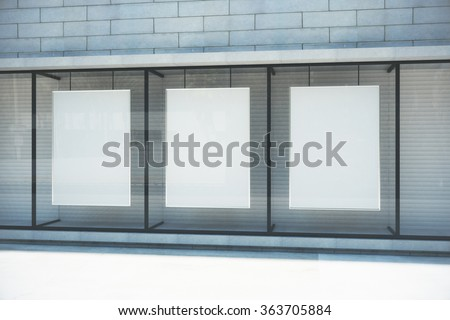 Blank white posters in glassy showcase on the street, mock up - stock photo