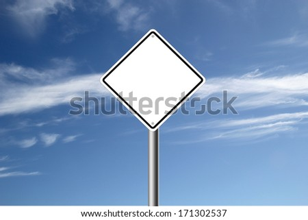 Blank white road sign isolated on blue sky background.