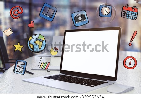 Blank white screen of laptop with social media icons - stock photo