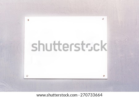 Blank white sign board on wooden background - stock photo