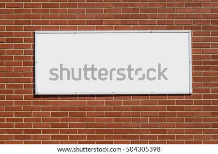 Blank White Sign for your Copy on Brick Wall