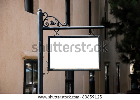 Blank white sign with a copy space area hanged from a pole