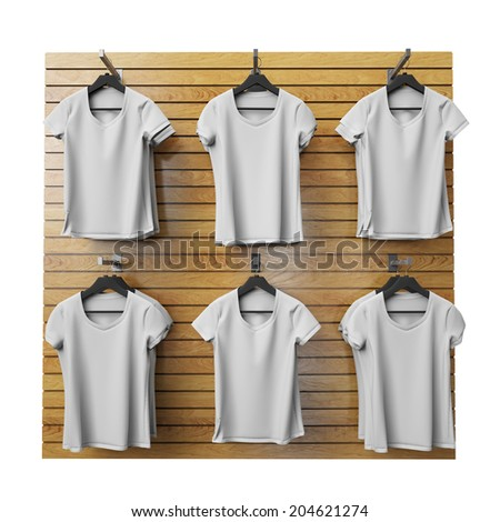 blank white t-shirts hanging on wooden shop stand, isolated on white background - stock photo